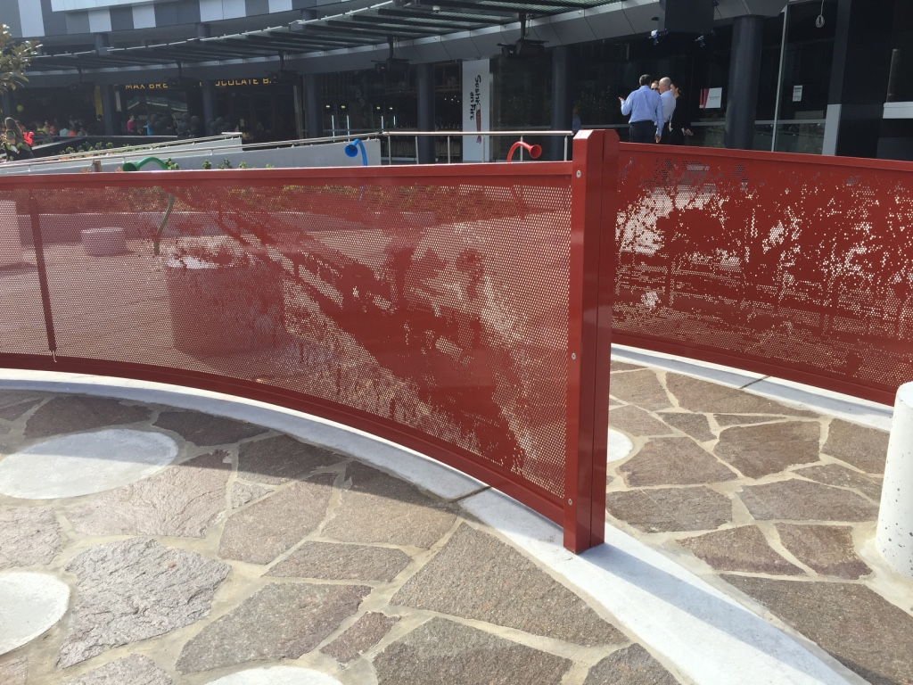 Perforated metal screens with graphics