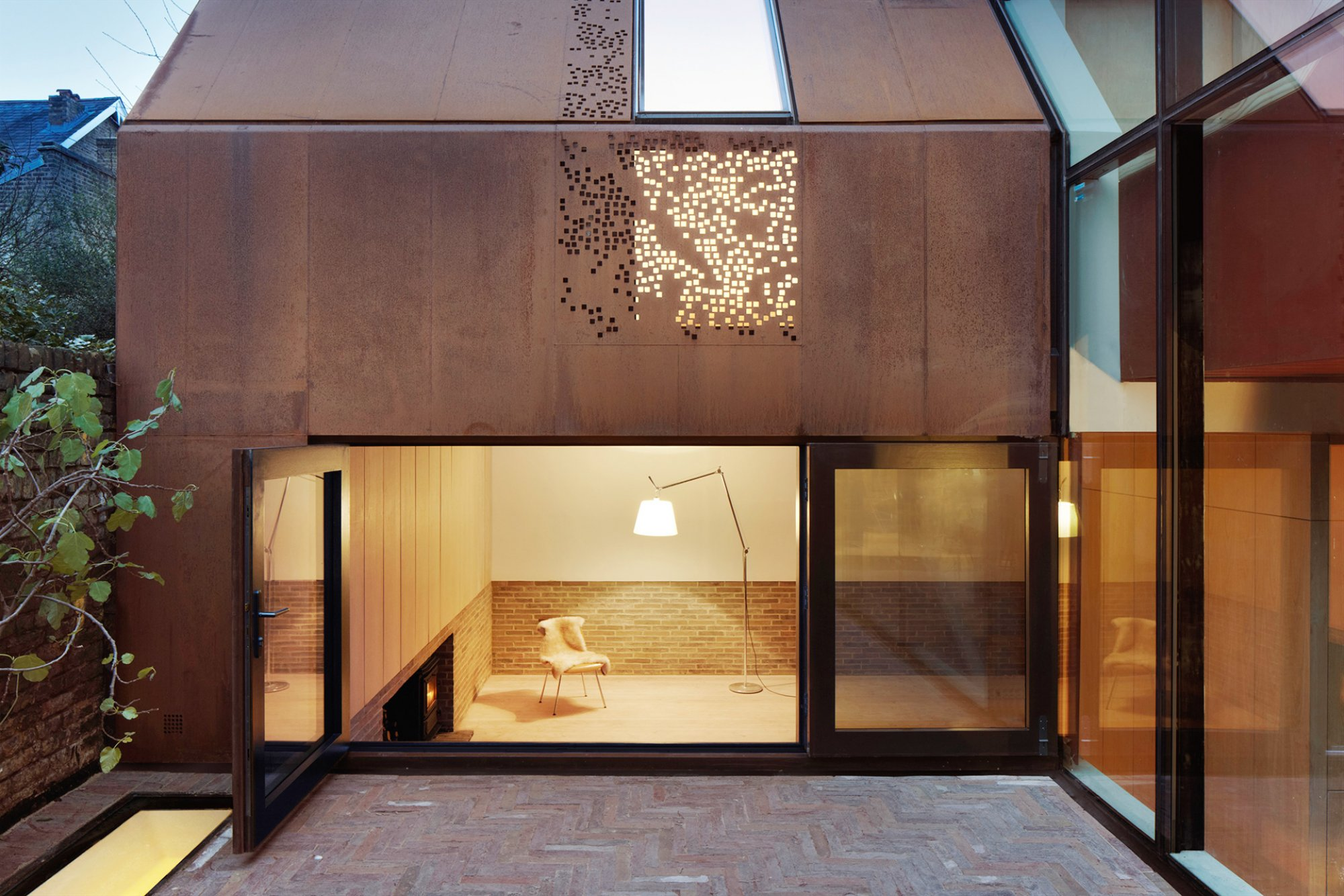 Square hole perforated metal walls - residential project