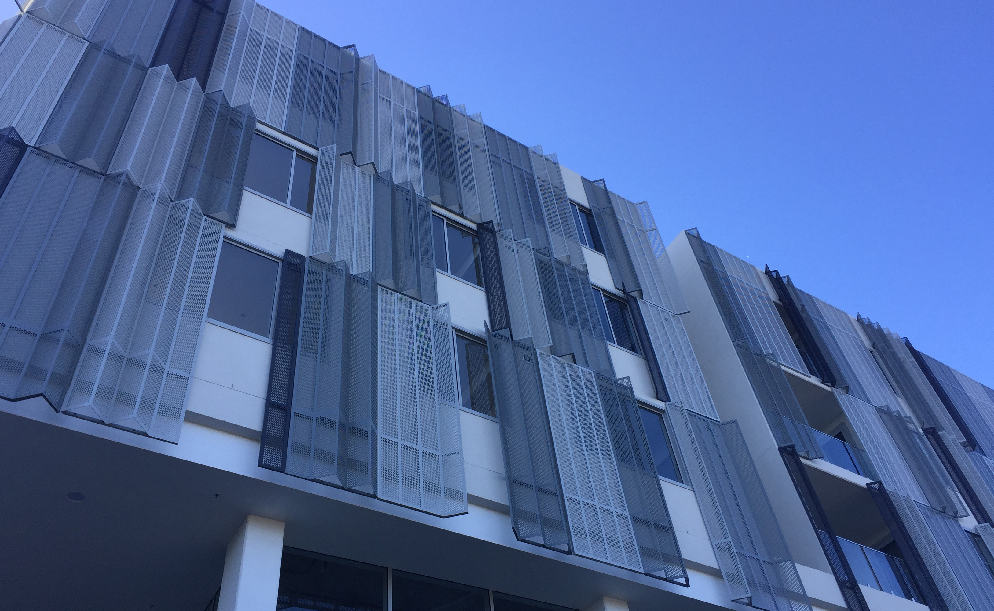 Perforated metal projects 2018 - Infinity building canterbury