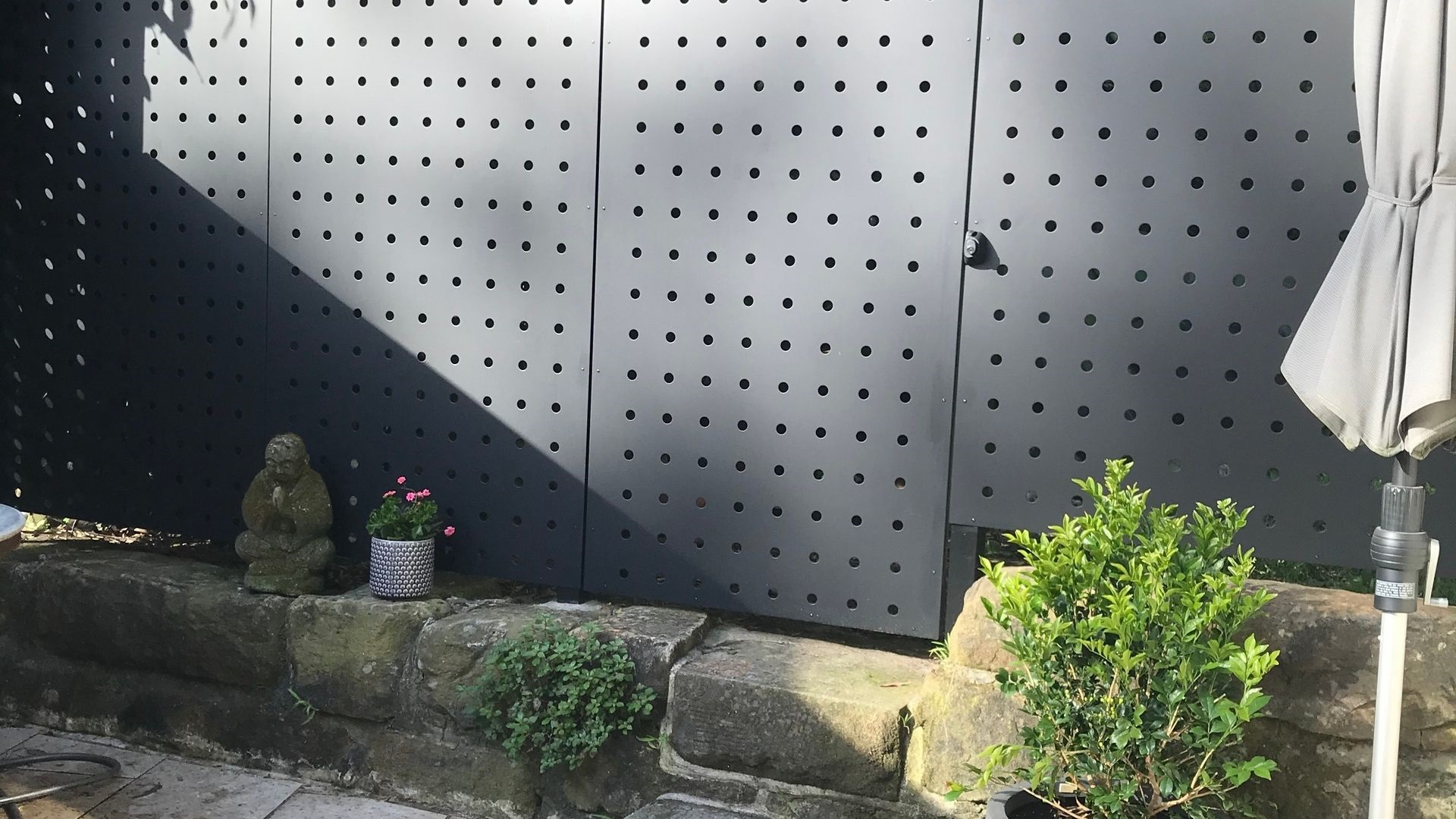 Bespoke perforated metal fence panels by Arrow Metal at a Sydney residence