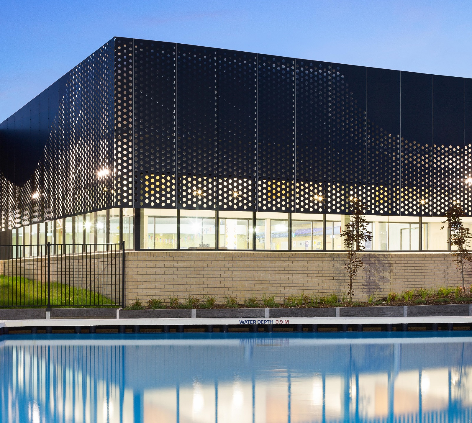 Perforated sheet metal facade by Arrow Metal - Bunburry Swimming Pool project