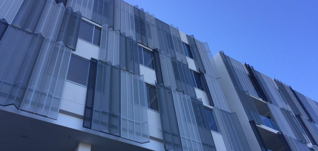 Perforated sheet by Arrow Metal - Infinity Apartments folded private screen panels