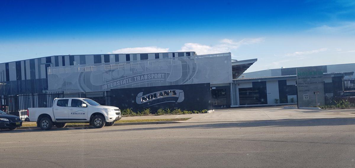 Perforated aluminium - Nolan's Transport building facade