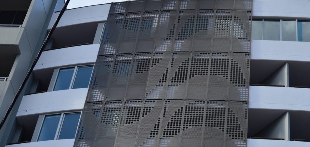 Large perforated metal patterns - Bayside St Apartment